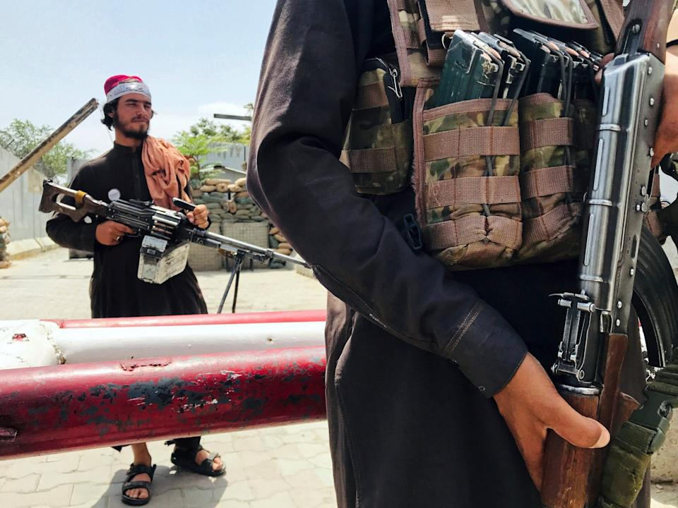 Taliban soldiers with guns.