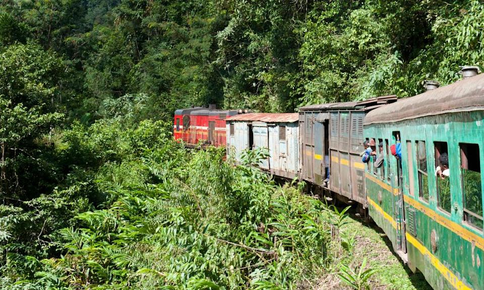 Vintage train traveling through jungle, Fianarantsoa-Cote Est
