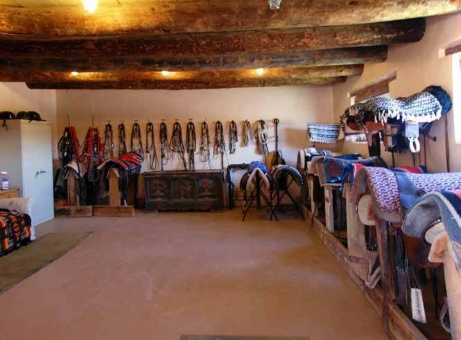 """<p>Fonda renovated the barn as a 12-stall stable. The equestrian facilities plus paddocks and pastures """"could comfortably handle a sizable remuda or a few personal saddle horses,"""" <a href=""""http://bit.ly/1oZ16Zz"""" rel=""""nofollow noopener"""" target=""""_blank"""" data-ylk=""""slk:Swan Land Co."""" class=""""link rapid-noclick-resp"""">Swan Land Co.</a> says in its promotional materials.<i> <i>(Photo: <a href=""""http://bit.ly/1oZ16Zz"""" rel=""""nofollow noopener"""" target=""""_blank"""" data-ylk=""""slk:Swan Land Company"""" class=""""link rapid-noclick-resp"""">Swan Land Company</a>)</i><br></i></p>"""