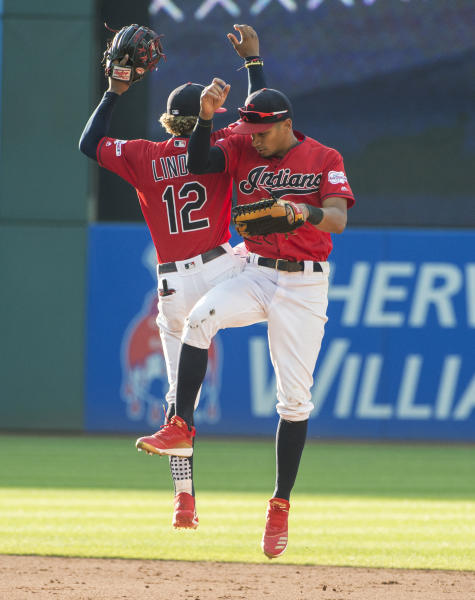 Cleveland Indians' Oscar Mercado celebrates with Francisco Lindor after the Indians' 5-1 win over the Texas Rangers in the second game of a baseball doubleheader in Cleveland, Wednesday, Aug. 7, 2019. It was a diving catch in center field by Mercado of a Danny Santana line drive for the third out that preserved the win. (AP Photo/Phil Long)