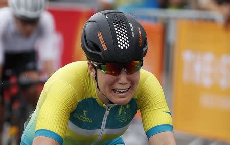 Cycling - Gold Coast 2018 Commonwealth Games - Women's Road Race - Currumbin Beachfront - Gold Coast, Australia - April 14, 2018. Chloe Hosking of Australia wins the race. REUTERS/Paul Childs