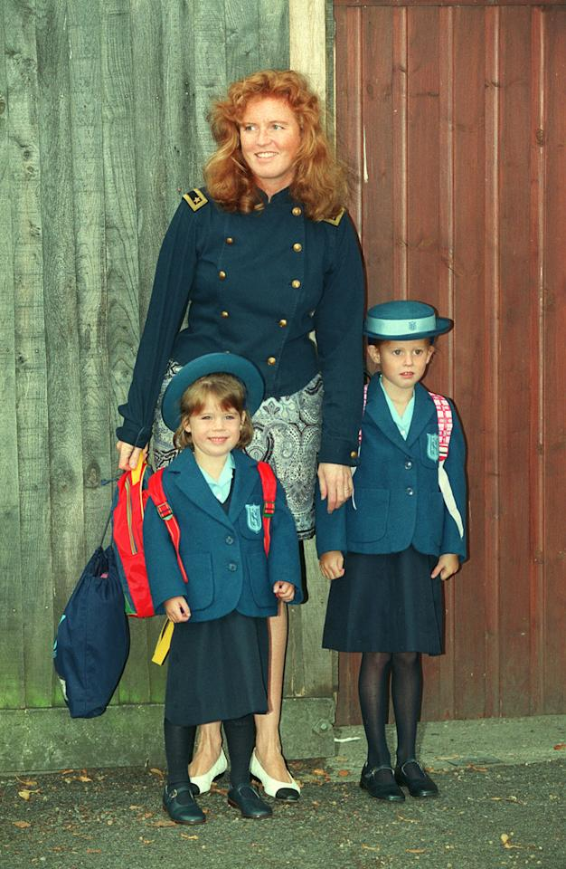 The Duchess of York taking her daughters Princess Eugenie (left) and Beatrice to Upton House school, in Windsor. It marked Eugenie's first day at school in 1992. [Photo: PA]