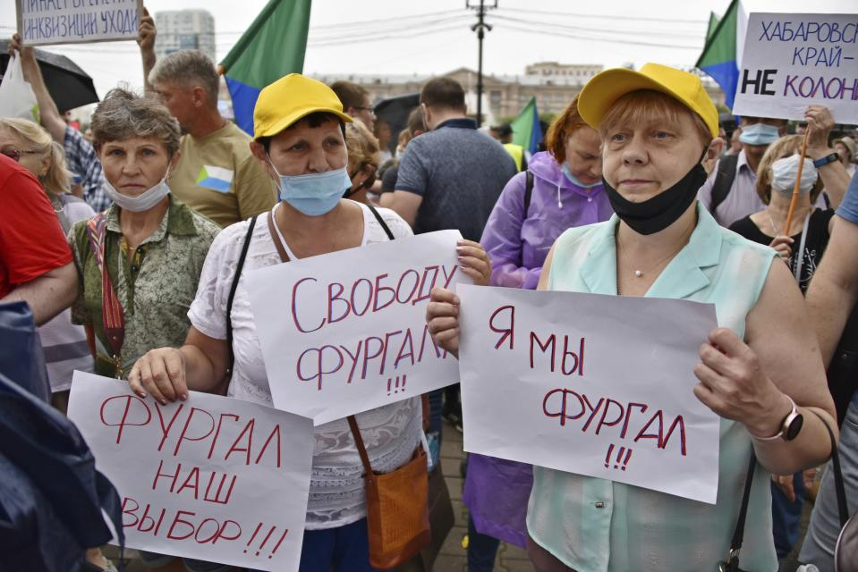 """Women hold posters reading """"Freedom for Furgal, Furgal is our choice, I'm/we are Furgal"""" during a rally supporting Khabarovsk region's governor Sergei Furgal in Khabarovsk, 6,100 kilometers (3,800 miles) east of Moscow, Russia, Saturday, Aug. 1, 2020. Thousands of demonstrators rallied Saturday in the Russian Far East city of Khabarovsk to protest the arrest of the regional governor, continuing a three-week wave of opposition that has challenged the Kremlin. (AP Photo/Igor Volkov)"""