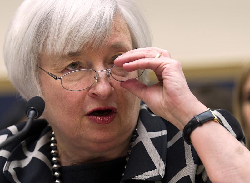 """Federal Reserve Chair Janet Yellen testifies on Capitol Hill in Washington, Tuesday, Feb. 11, 2014, before the House Financial Services Committee hearing. Yellen said Tuesday that if the economy keeps improving, the Fed will take """"further measured steps"""" to reduce the support it's providing through monthly bond purchases. (AP Photo/Cliff Owen)"""