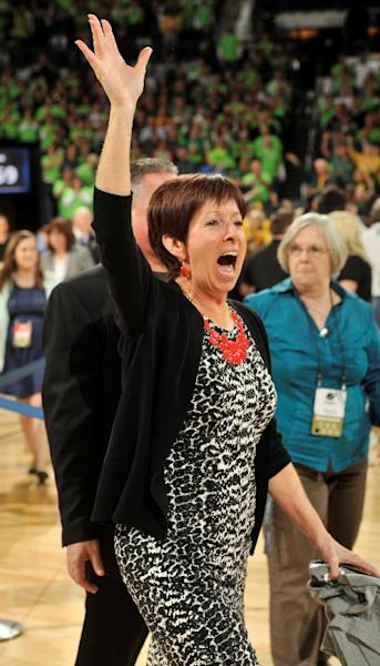 Notre Dame coach Muffet McGraw waves at the crowd after the second half of their NCAA women's college basketball tournament regional final game at the Purcell Pavilion in South Bend, Ind Monday March 31, 2014. Notre Dame won 88-69. (AP Photo/Joe Raymond)