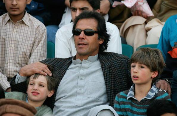 RAWALPINDI, PAKISTAN - DECEMBER 19:  Former Pakistan cricket team captain Imran Khan and his sons Qasim and Suleiman Khan watch the action during the fourth one day international match between Pakistan and England at The Rawalpindi Cricket Stadium on December 19, 2005 in Rawalpindi, Pakistan.  (Photo by Paul Gilham/Getty Images)