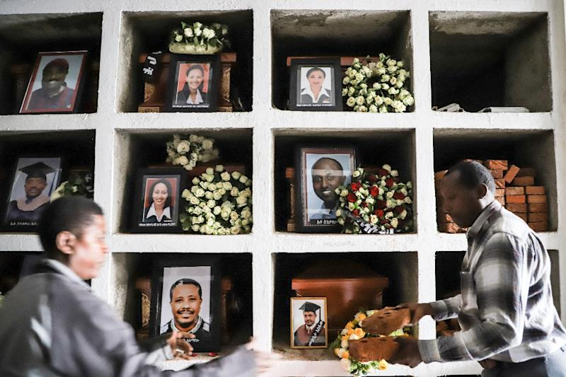 Portraits of victims from the Ethiopian Airlines Boeing 737 MAX crash are displayed during a mass funeral at Holy Trinity Cathedral in Addis Ababa, Ethiopia, on March 17, 2019 (AFP Photo/Michael TEWELDE)
