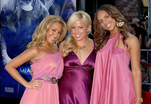 Adrienne Bailon (left) with fellow Cheetah Girls Sabrina Bryan and Kiely Williams in 2006. (Photo: Gregg DeGuire/WireImage)