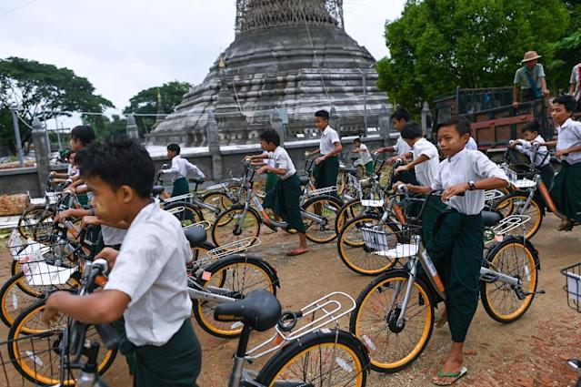 Children aged 13-16 living more than two kilometres from school will be at the front of the queue for donated bikes (AFP Photo/Ye Aung THU)