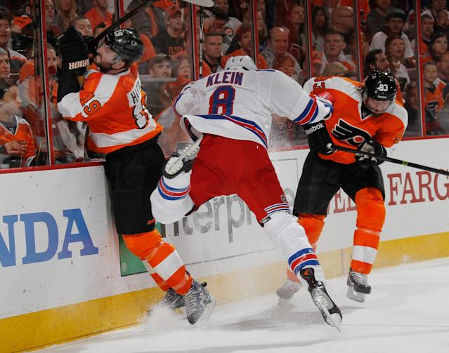 PHILADELPHIA, PA - APRIL 25: Kevin Klein #8 of the New York Rangers is hit by Scott Hartnell #19 of the Philadelphia Flyers during the second period in Game Four of the First Round of the 2014 NHL Stanley Cup Playoffs at the Wells Fargo Center on April 25, 2014 in Philadelphia, Pennsylvania. (Photo by Bruce Bennett/Getty Images)