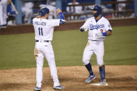 Los Angeles Dodgers' A.J. Pollock, left, congratulates Chris Taylor after Taylor's two-run home run during the sixth inning of a baseball game against the Colorado Rockies in Los Angeles, Sunday, Sept. 6, 2020. (AP Photo/Kelvin Kuo)