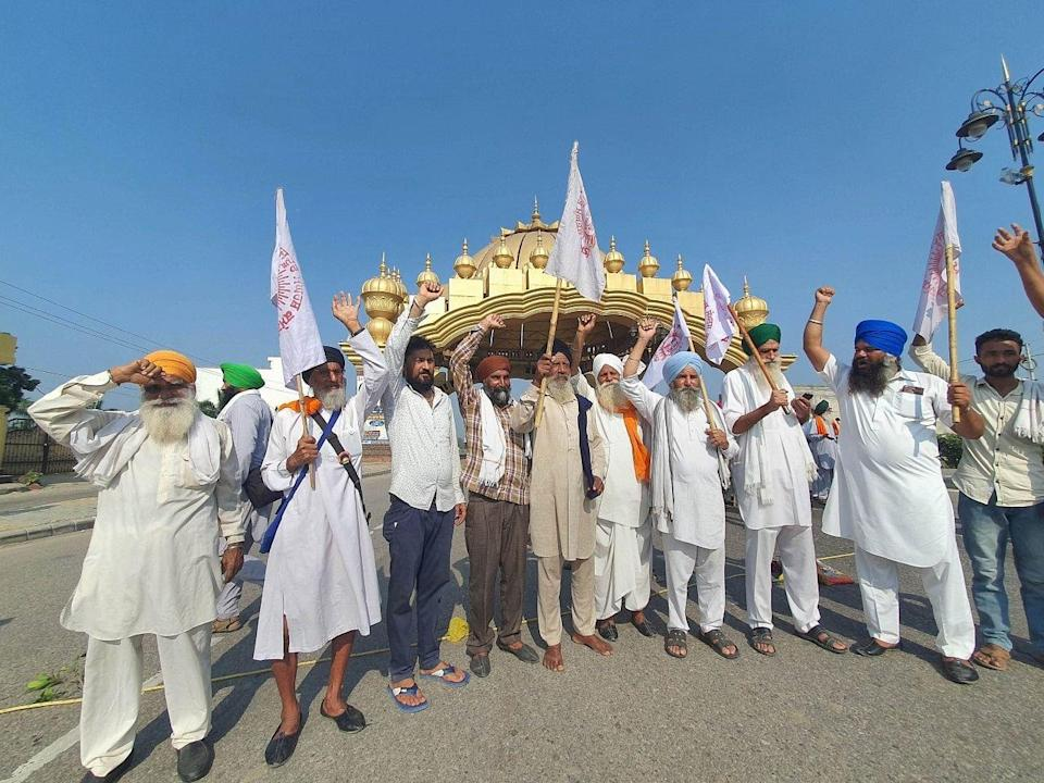 """<div class=""""paragraphs""""><p>Amritsar: Farmers of various organisations protest at Golden Gate during their Bharat Bandh strike against central governments three farm reform laws.</p></div>"""