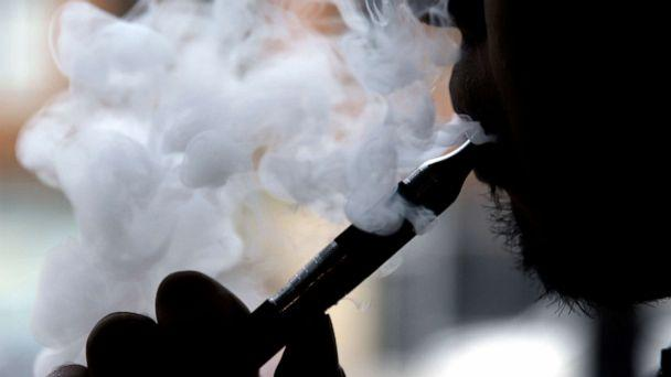 PHOTO: In this April 23, 2014 file photo, a man smokes an electronic cigarette in Chicago. (Nam Y. Huh/AP)