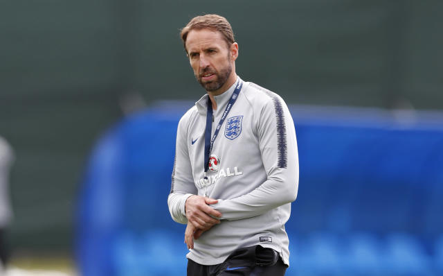England head coach Gareth Southgate, his right arm in a sling after dislocating his shoulder during England's scheduled day off on Wednesday, watches his players take part in a training session for the England team at the 2018 soccer World Cup, in the Spartak Zelenogorsk ground, Zelenogorsk near St. Petersburg, Russia, Thursday, June 21, 2018. (AP Photo/Alastair Grant)