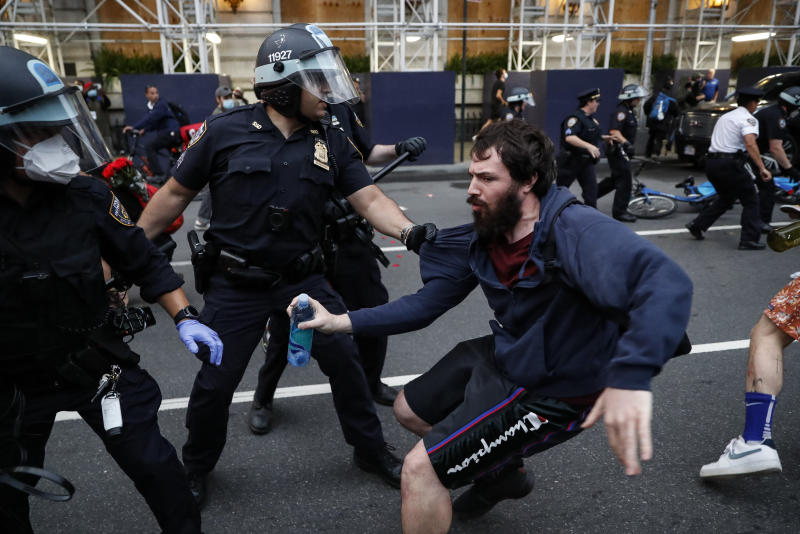 A protester is arrested for violating curfew near the Plaza Hotel on Wednesday, June 3, 2020, in the Manhattan borough of New York. Protests continued following the death of George Floyd, who died after being restrained by Minneapolis police officers on May 25. (AP Photo/John Minchillo)