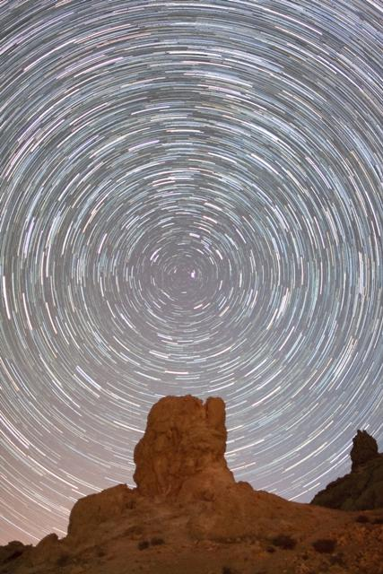 Runner-up (Young Astronomer) 'Starry Night Sky' by Nicole Sullivan (USA, age 15) Star trails above the Sierra Nevada mountain range on 30 June 2011. The long exposure captures how the stars appear to circle the Pole Star as the Earth rotates on its axis.