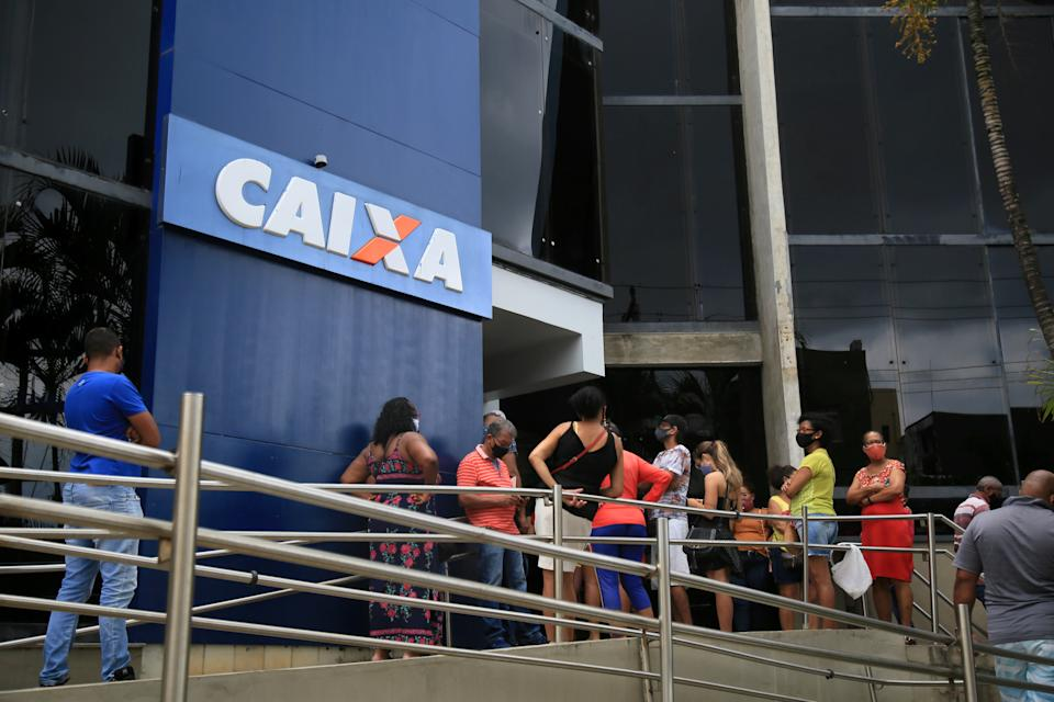 salvador, bahia, brazil - february 5, 2021: people are seen at the front door of a branch of Caixa Economica Federal bank in the Rio Vermelho neighborhood in the city of Salvador.