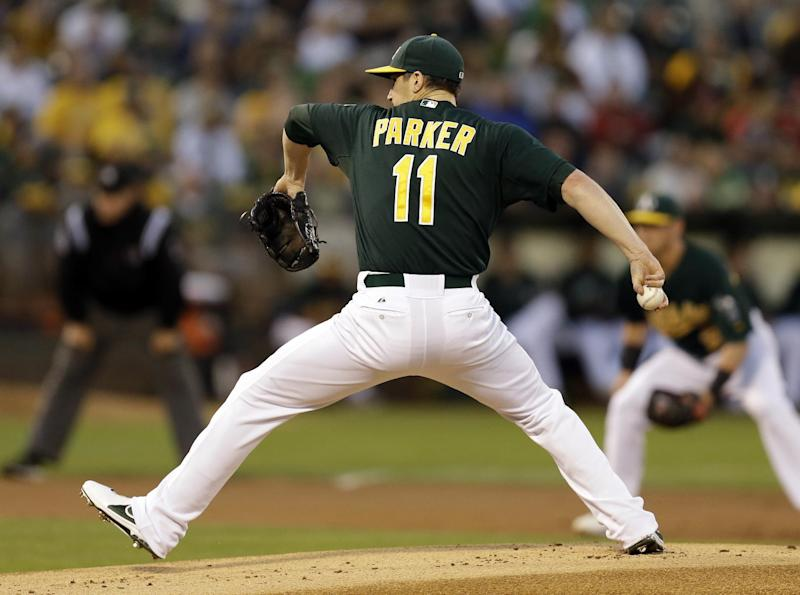Oakland Athletics' Jarrod Parker works against the Los Angeles Angels in the first inning of a baseball game, Monday, Sept. 16, 2013, in Oakland, Calif. (AP Photo/Ben Margot)