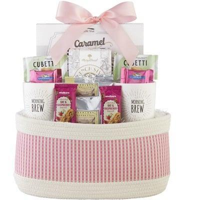 <p>Treat her to the ultimate coffee-themed gift basket with the <span>1-800-Baskets Mother's Day Coffee Gift Basket, includes 2 White Stoneware Mugs, Ghirardelli Chocolate and French Ground coffee</span> ($70). It includes two white stoneware mugs, Ghirardelli chocolate and French ground coffee.</p>