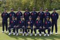 Team USA poses for a picture on the 18th hole during a practice day at the Ryder Cup at the Whistling Straits Golf Course Wednesday, Sept. 22, 2021, in Sheboygan, Wis. (AP Photo/Charlie Neibergall)