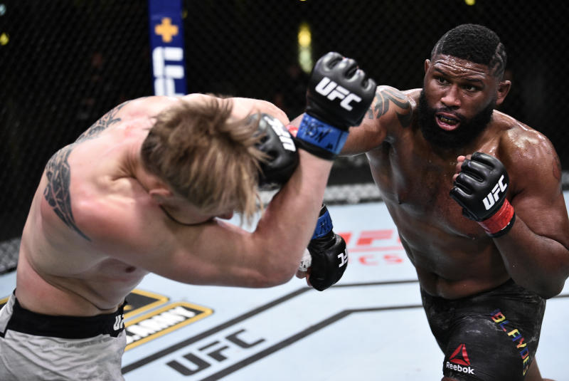LAS VEGAS, NEVADA - JUNE 20: In this handout image provided by UFC, (R-L) Curtis Blaydes punches Alexander Volkov of Russia in their heavyweight bout during the UFC Fight Night event at UFC APEX on June 20, 2020 in Las Vegas, Nevada. (Photo by Chris Unger/Zuffa LLC via Getty Images)