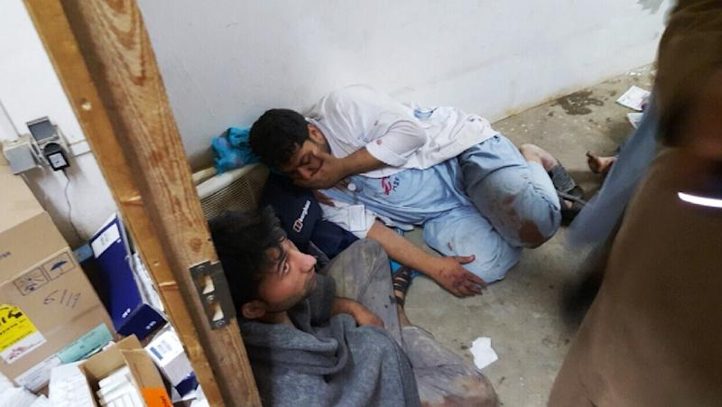In this photograph released by Medecins Sans Frontieres (MSF) on October 3, 2015, Afghan MSF staff react in one of the remaining parts of the MSF hospital in Kunduz after it was hit by an air strike (AFP Photo/)