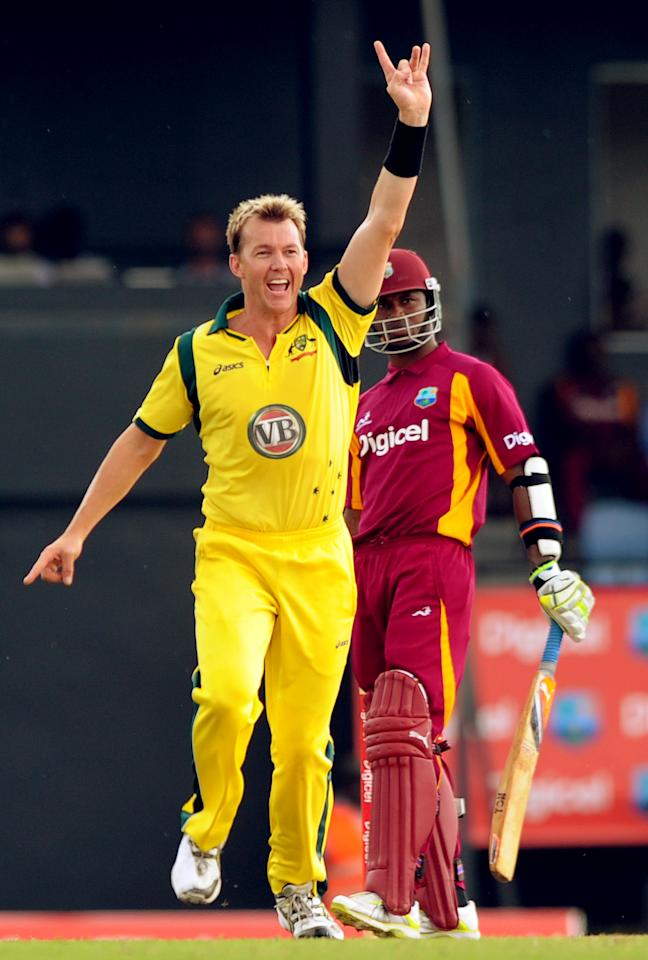 Australian cricketer Brett Lee (L) celebrates after dismissing West Indies batsman Marlon Samuels (R) during the fifth-of-five One-Day International (ODI) matches between West Indies and Australia at the Beausejour Cricket Ground in Gros Islet on March 25, 2012.     AFP PHOTO/Jim Watson (Photo credit should read JIM WATSON/AFP/Getty Images)