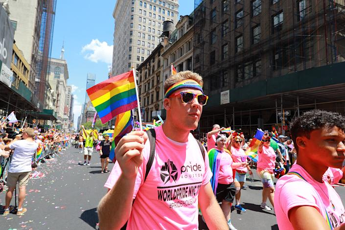 A man waves a rainbow flag during the NYC Pride Parade in New York, Sunday, June 30, 2019. (Gordon Donovan/Yahoo News)