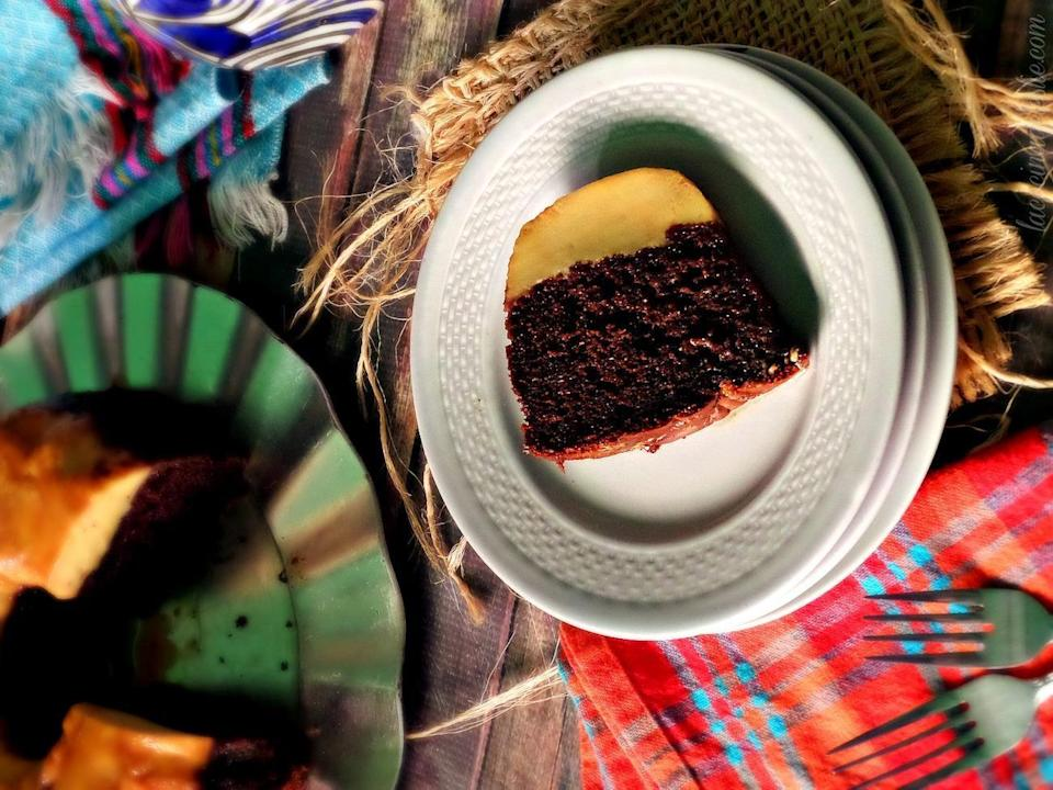 """<p>Sometimes called pastel impossible or impossible cake, chocoflan lives up to its nickname. In a seemingly impossible and <a href=""""https://www.thedailymeal.com/cook/bake-cookies-unexpected-ingredients?referrer=yahoo&category=beauty_food&include_utm=1&utm_medium=referral&utm_source=yahoo&utm_campaign=feed"""" rel=""""nofollow noopener"""" target=""""_blank"""" data-ylk=""""slk:unexpected twist"""" class=""""link rapid-noclick-resp"""">unexpected twist</a>, chocolate cake only adds to flan's inherent yumminess.</p> <p><strong><a href=""""https://www.thedailymeal.com/best-recipes/chocoflan-pastel-impossible?referrer=yahoo&category=beauty_food&include_utm=1&utm_medium=referral&utm_source=yahoo&utm_campaign=feed"""" rel=""""nofollow noopener"""" target=""""_blank"""" data-ylk=""""slk:For the Chocoflan recipe, click here."""" class=""""link rapid-noclick-resp"""">For the Chocoflan recipe, click here.</a></strong></p>"""