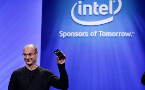 Andy Rubin, holds up a Google Android phone in 2011 - Credit: AP