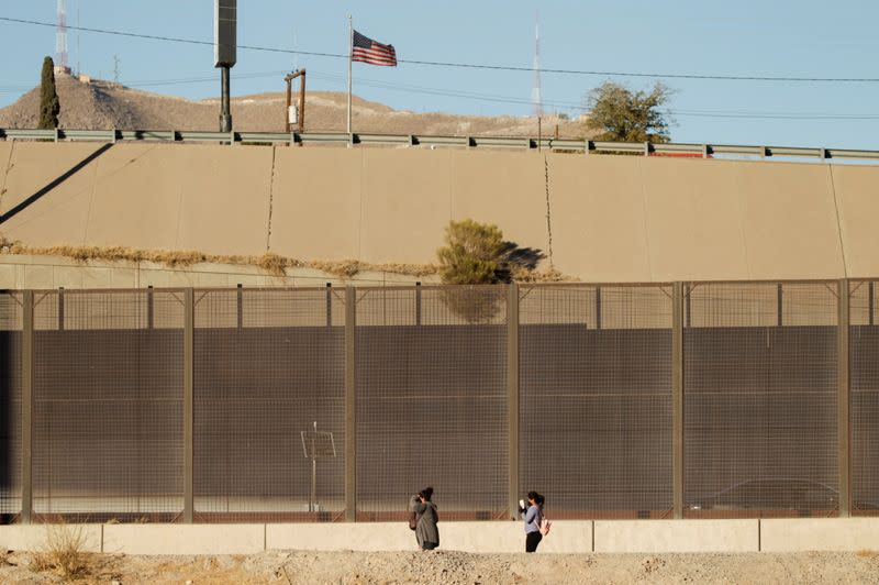 Migrants are seen after crossing the Rio Bravo river to turn themselves in to U.S Border Patrol agents to request for asylum in El Paso, Texas, U.S., as seen from Ciudad Juarez