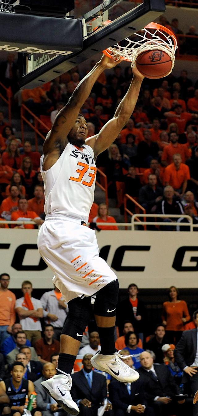 Oklahoma State guard Marcus Smart dunks the basketball during the first half of an NCAA college basketball game in Stillwater, Okla., Tuesday, Nov. 19, 2013. (AP Photo/Brody Schmidt)