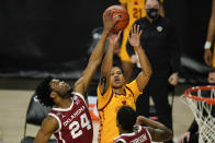 Oklahoma guard Elijah Harkless (24) blocks a shot by Iowa State guard Rasir Bolton during the second half of an NCAA college basketball game, Saturday, Feb. 20, 2021, in Ames, Iowa. (AP Photo/Charlie Neibergall)