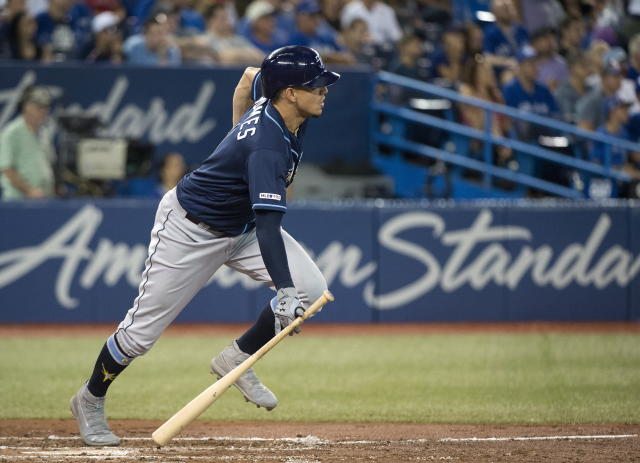Tampa Bay Rays shortstop Willy Adames (1) hits a single during the third inning of a baseball game against the Toronto Blue Jays, Saturday, July 27, 2019 in Toronto. (Nathan Denette/Canadian Press via AP)