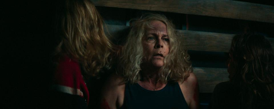 """Laurie Strode (Jamie Lee Curtis) recovers from a gnarly stab wound with Michael Myers on the loose in Haddonfield in """"Halloween Kills."""""""