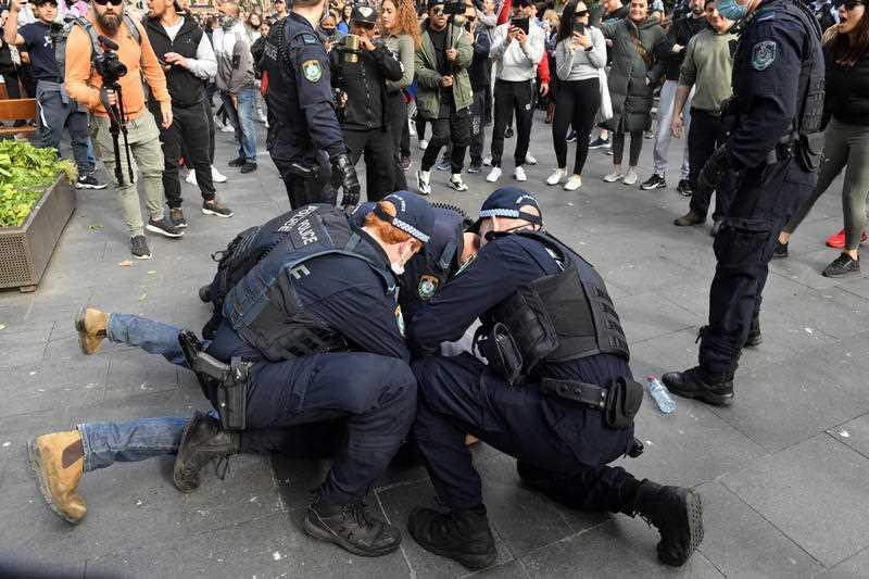 Protesters are arrested by the police at Sydney Town Hall during the 'World Wide Rally For Freedom' anti-lockdown rally at Hyde Park in Sydney.