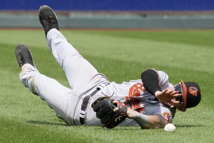 Baltimore Orioles right fielder Austin Hays fails to catch a fly ball hit by Kansas City Royals Hunter Dozier during the seventh inning of a baseball game at Kauffman Stadium in Kansas City, Mo., Sunday, July 18 2021. Dozier doubled on the play. (AP Photo/Orlin Wagner)