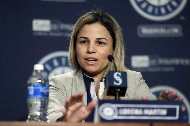 """FILE - In this Jan. 25, 2018, file photo, Lorena Martin, Seattle Mariners' director of high performance, speaks during the Mariners annual media briefing before the start of spring training baseball, in Seattle. Major League Baseball's independent investigation found no credible evidence to support claims of disparaging comments and discriminatory treatment by members of the Seattle Mariners front office. MLB said in a statement Wednesday, Feb. 6, 2019, that the investigation found the Mariners did not violate baseball's """"workplace code of conduct, or applicable anti-discrimination law,"""" in the treatment of Lorena Martin or in her termination by the club. (AP Photo/Ted S. Warren, File)"""