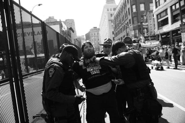 <p>Police detain a protester outside the convention center. (Photo: Khue Bui for Yahoo News)<br></p>