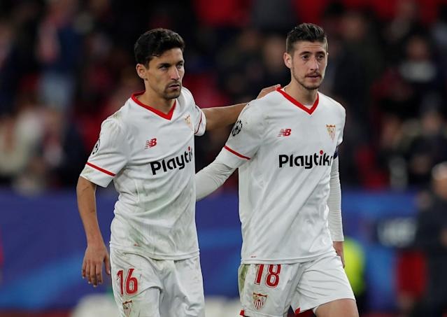 Soccer Football - Champions League Round of 16 First Leg - Sevilla vs Manchester United - Ramon Sanchez Pizjuan, Seville, Spain - February 21, 2018 Sevilla's Jesus Navas (L) and Sergio Escudero look dejected after the match Action Images via Reuters/Andrew Couldridge