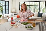 <p>Zoey Deutch toasts to National Pizza Month with an Aperol Spritz at home. </p>