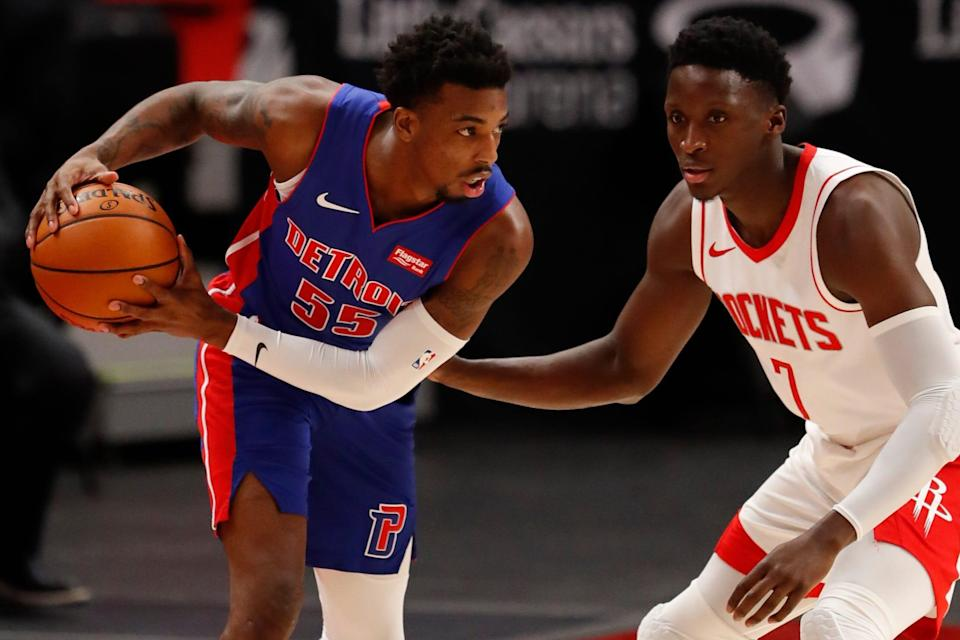 Detroit Pistons guard Delon Wright is defended by Houston Rockets guard Victor Oladipo during the first quarter Friday, Jan. 22, 2021 at Little Caesars Arena.