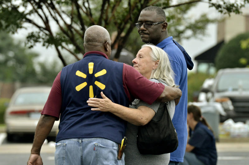 People console one another after a shooting at a Walmart store Tuesday, July 30, 2019 in Southaven, Miss. (Photo: Brandon Dill/AP)