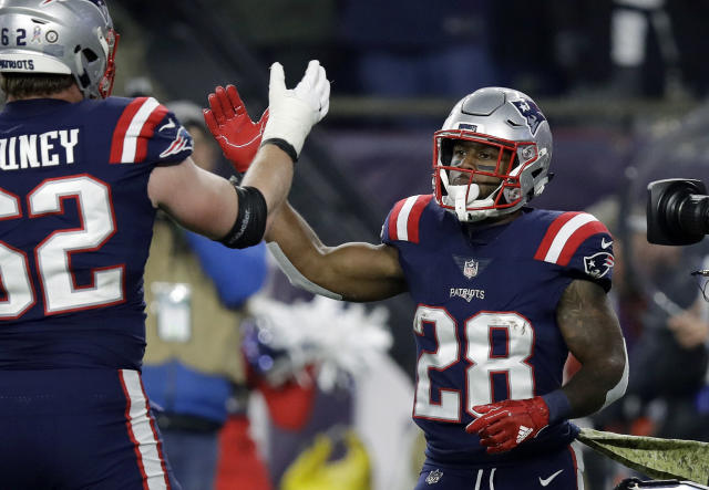 New England Patriots running back James White, right, celebrates his touchdown run with Joe Thuney, left, during the first half of an NFL football game against the New England Patriots, Sunday, Nov. 4, 2018, in Foxborough, Mass. (AP Photo/Charles Krupa)