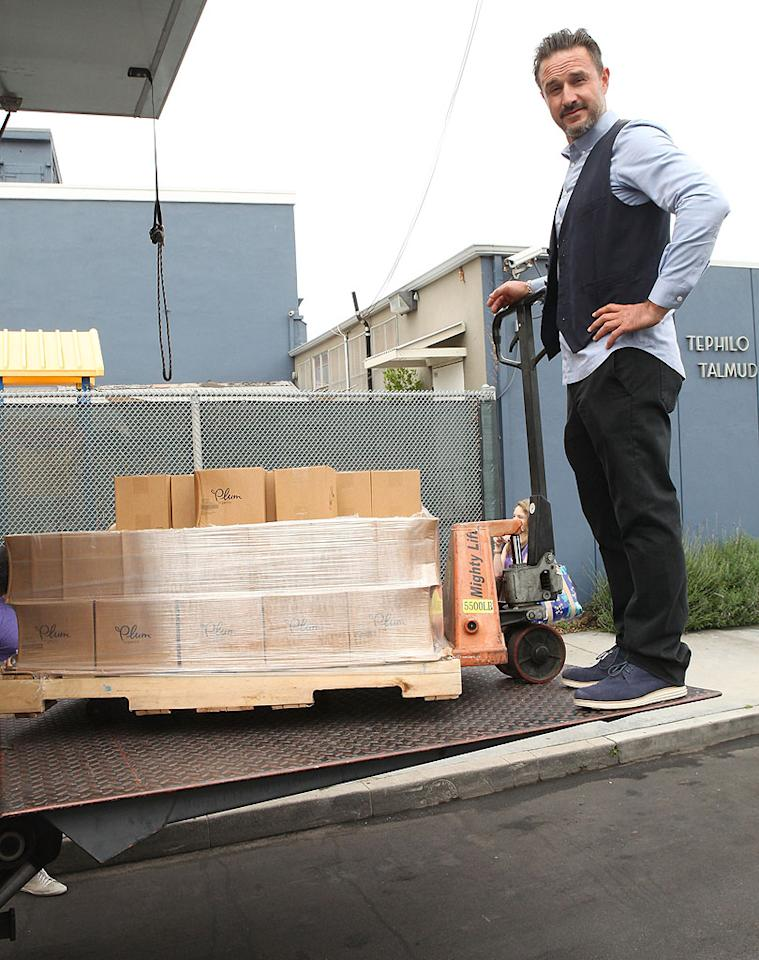 "David Arquette proudly lent a hand in Venice, California, on Wednesday when he unloaded boxes at the St. Joseph Center, which helps needy families. The delivery was from online retailer ecomom, which has launched a giving program called ""It's All Good,"" focused on delivering meals to food pantries around the country. (5/30/2012)"