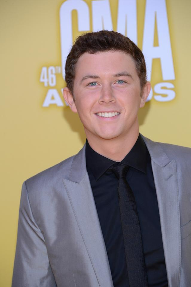"""<p class=""""MsoNormal""""><span style=""""color:black;"""">""""American Idol"""" winner Scotty McCreery revved up his casual look with a black shirt-and-tie combo and a gray sports jacket. Do you think he'll win a CMA Award one day? (11/1/2012)<br></span></p>"""
