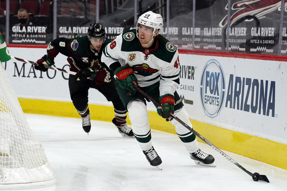 Minnesota Wild center Victor Rask (49) skates away from Arizona Coyotes center Nick Schmaltz during the second period of an NHL hockey game Friday, March 5, 2021, in Glendale, Ariz. (AP Photo/Rick Scuteri)