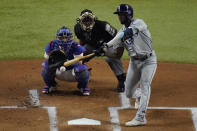 Tampa Bay Rays' Randy Arozarena hits home run during the first inning in Game 6 of the baseball World Series against the Los Angeles Dodgers Tuesday, Oct. 27, 2020, in Arlington, Texas. (AP Photo/Sue Ogrocki)