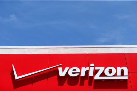 FILE PHOTO - A Verizon sign at a retail store in San Diego