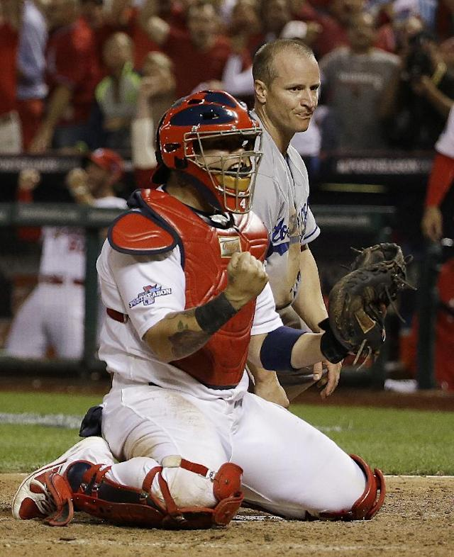 St. Louis Cardinals catcher Yadier Molina reacts after tagging out Los Angeles Dodgers' Mark Ellis at home during the 10th inning of Game 1 of the National League baseball championship series Friday, Oct. 11, 2013, in St. Louis. (AP Photo/David J. Phillip)